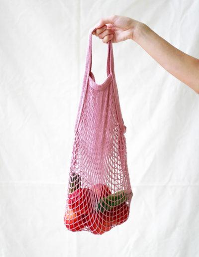 net-bag-hand-with-fruits-and-veggies-zero-waste-saigon